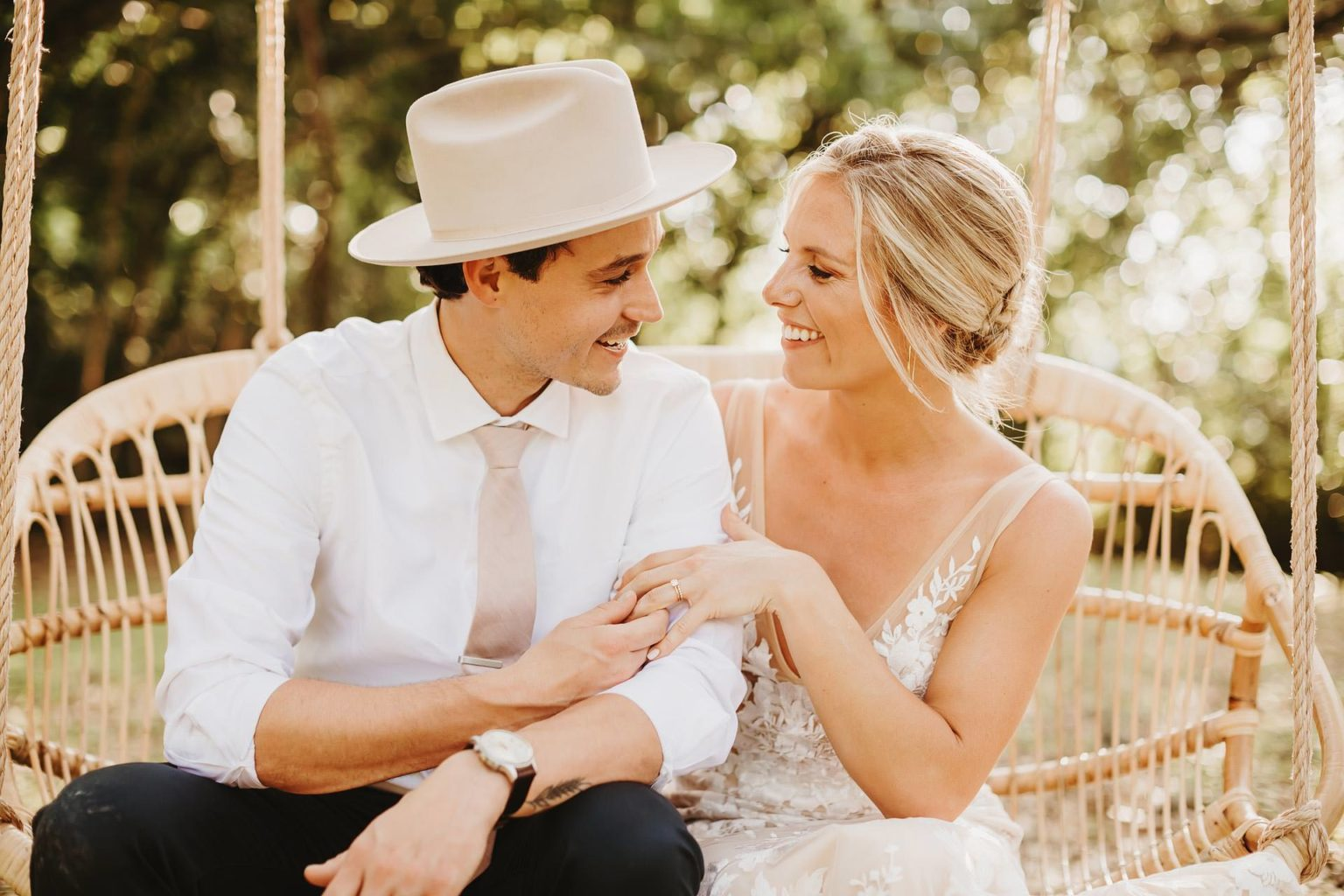 Mercury Hall Wedding Outdoor ceremony hill country oak trees hipster hat groom and bride